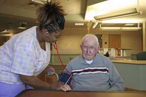 Nurse examining patient